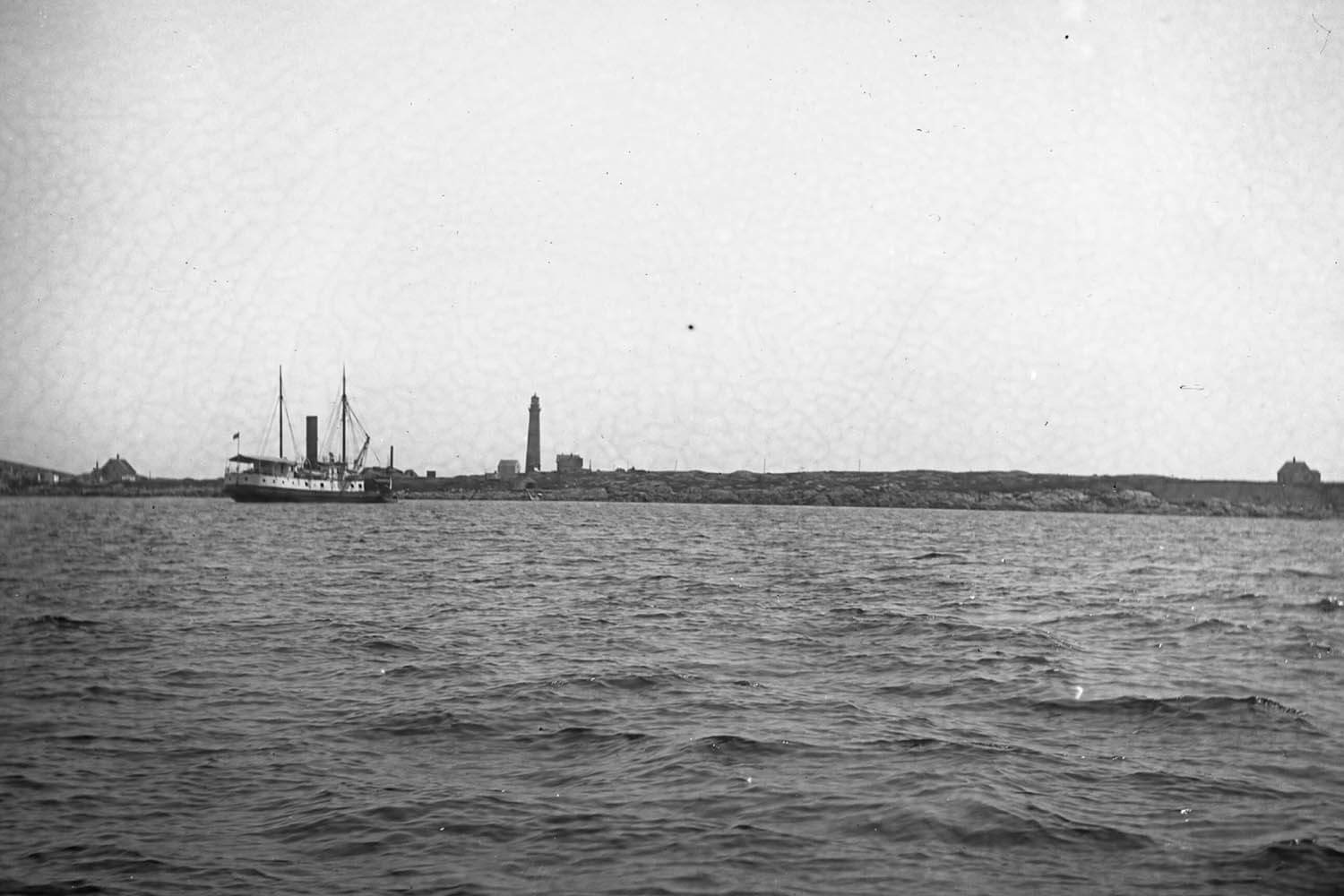 "Lighthouse tender USLHT ""Mayflower"" delivering coal and supplies on August 12, 1913."
