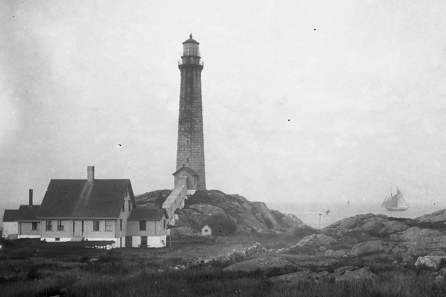 North tower with fishing schooner passing c.1910.